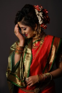 shy indian bride in her wedding attire