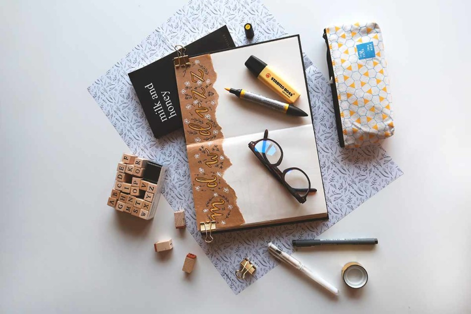 Planners, diaries and markers spread on a table